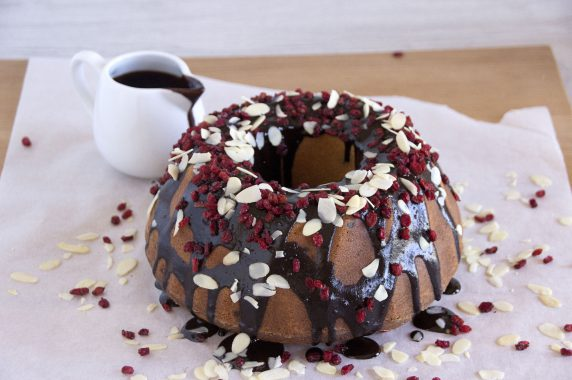 Ring Cake With Chocolate Sauce, Cranberry  and Flaked Almonds